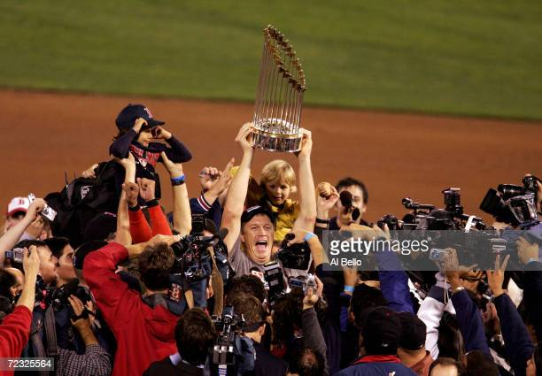 Mike Timlin of the Boston Red Sox celebrates with the trophy after defeating the St Louis Cardinals 30 in game four of the World Series on October 27...