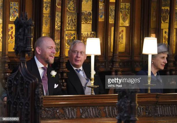 Mike Tindall and the Duke and Duchess of Gloucester take their seats at St George's Chapel at Windsor Castle before the wedding of Prince Harry to...