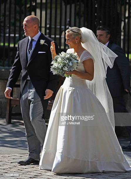 Mike Tindall and Zara Phillips depart after their Royal wedding at Canongate Kirk on July 30, 2011 in Edinburgh, Scotland. The Queen's granddaughter...