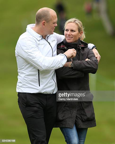 Mike Tindall and Zara Phillips share a moment at the BMW PGA Celebrity ProAm Golf Championship at Wentworth on May 25 2016 in Virginia Water England