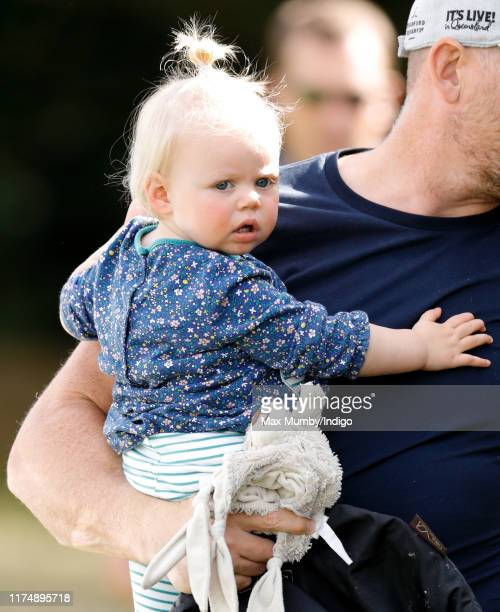 Mike Tindall carries daughter Lena Tindall as they attend day 3 of the Whatley Manor Gatcombe International Horse Trials at Gatcombe Park on...