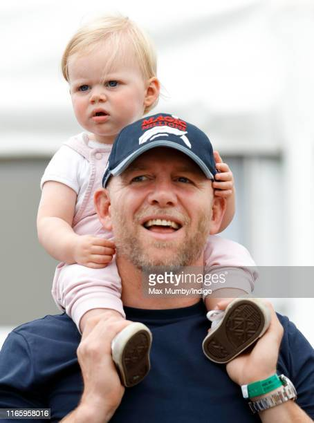 Mike Tindall carries daughter Lena Tindall on his shoulders as they attend day 2 of the 2019 Festival of British Eventing at Gatcombe Park on August...