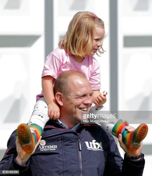 Mike Tindall carries daughter Mia Tindall on his shoulders as they attend day 1 of the Festival of British Eventing at Gatcombe Park on August 4 2017...