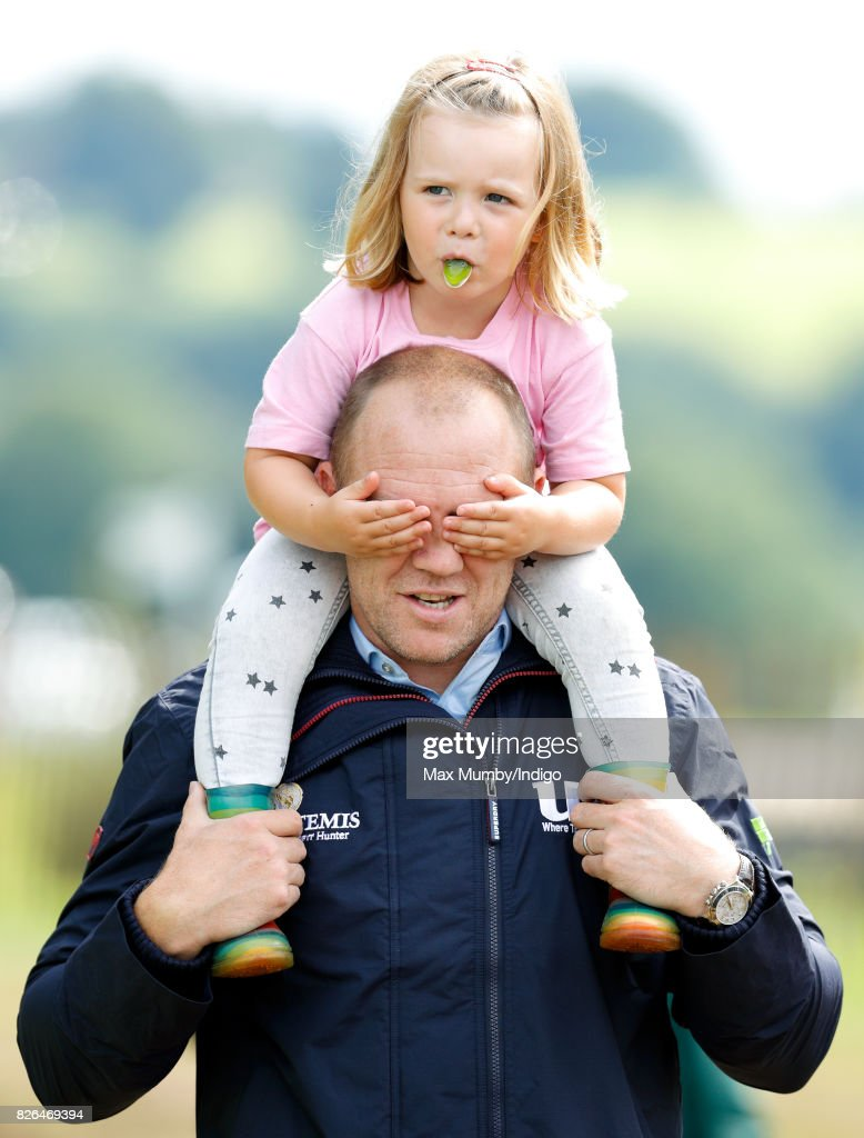 Mike Tindall carries daughter Mia Tindall on his shoulders as they attend day 1 of the Festival of British Eventing at Gatcombe Park on August 4, 2017 in Stroud, England.