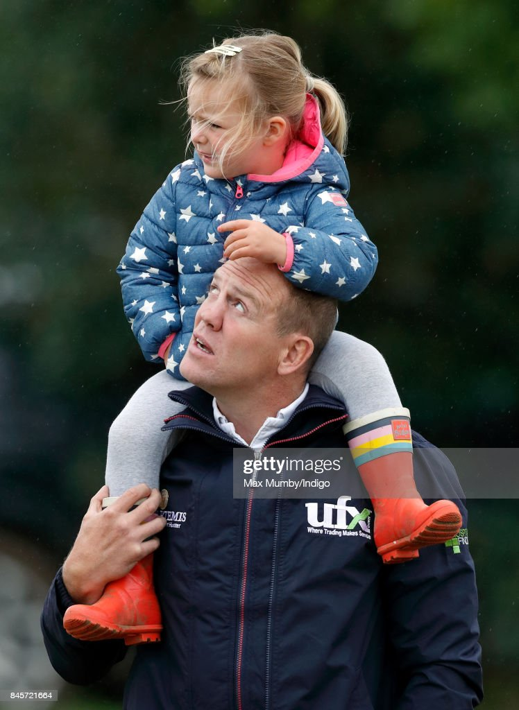 Mike Tindall carries daughter Mia Tindall on his shoulders as they attend day 3 of the Whatley Manor Horse Trials at Gatcombe Park on September 10, 2017 in Stroud, England.