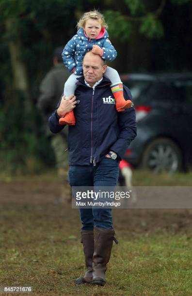 Mike Tindall carries daughter Mia Tindall on his shoulders as they attend day 3 of the Whatley Manor Horse Trials at Gatcombe Park on September 10...