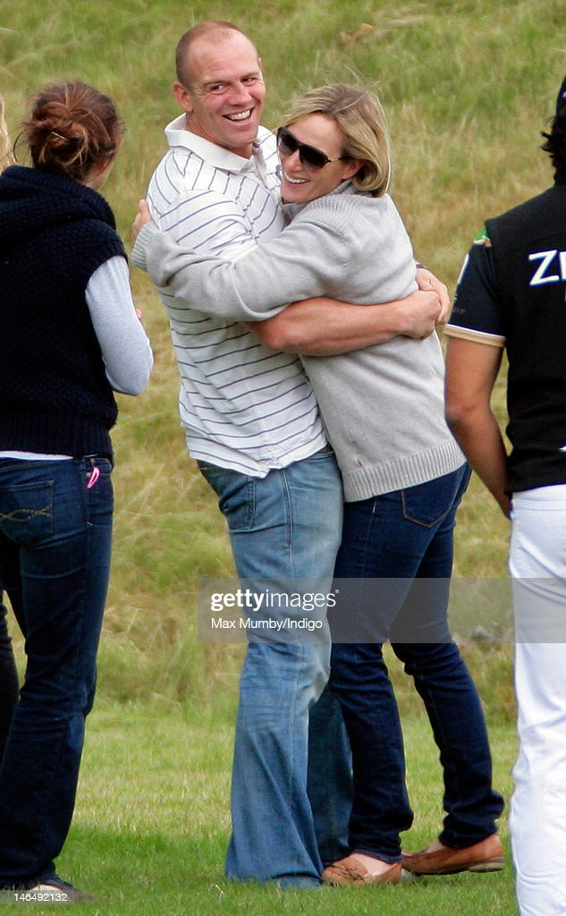 Mike Tindall embraces Zara Phillips as they attend The Golden Metropolitan Polo Club Charity Cup polo match, in which Prince William, Duke of Cambridge and Prince Harry played, at the Beaufort Polo Club on June 17, 2012 in Tetbury, England.