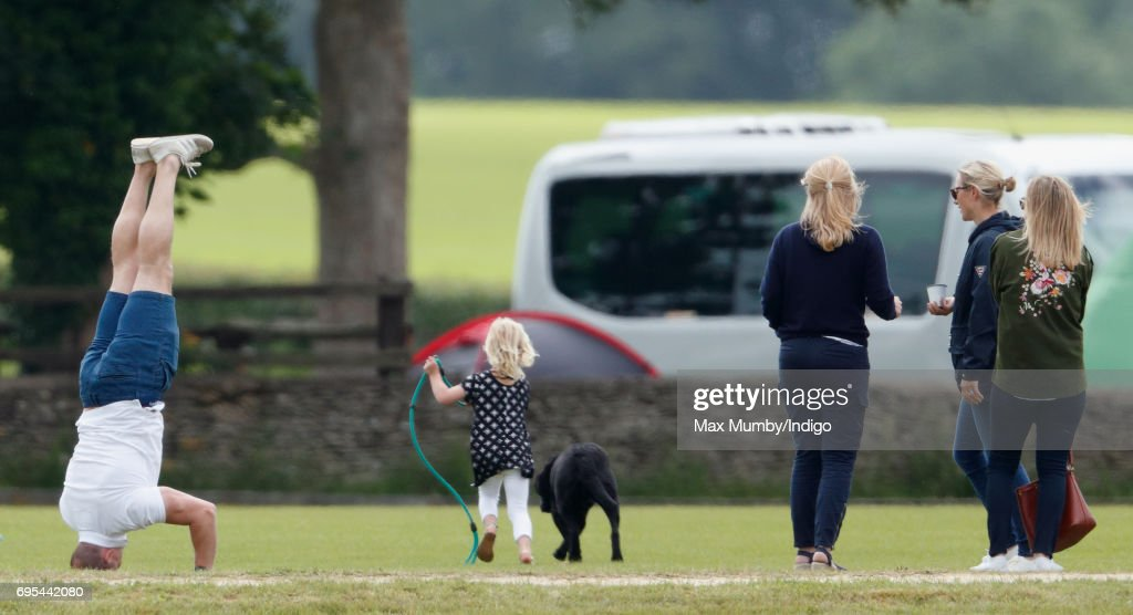 Mike Tindall (doing a headstand), Isla Phillips (c), Autumn Phillips (3rd r), Zara Philllips (2nd r) and Alejandra Borwick (r) attend the Maserati Royal Charity Polo Trophy Match during the Gloucestershire Festival of Polo at the Beaufort Polo Club on June 11, 2017 in Tetbury, England.