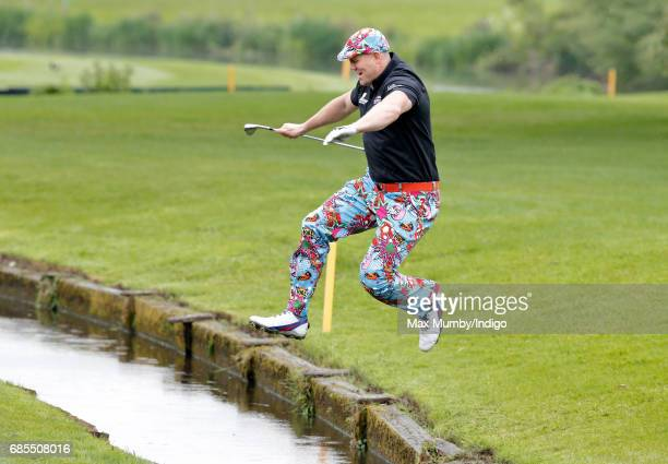 Mike Tindall jumps over a stream as he takes part in the 5th edition of the 'ISPS Handa Mike Tindall Celebrity Golf Classic' at The Belfry on May 19...