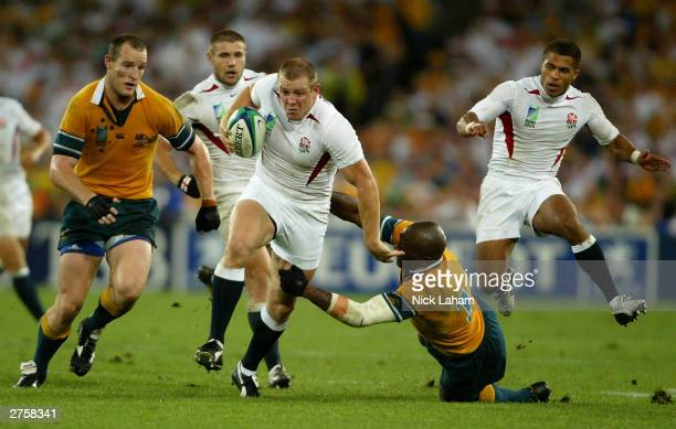 Mike Tindall of England breaks the tackle of Wendell Sailor of Australia during the Rugby World Cup Final match between Australia and England at...