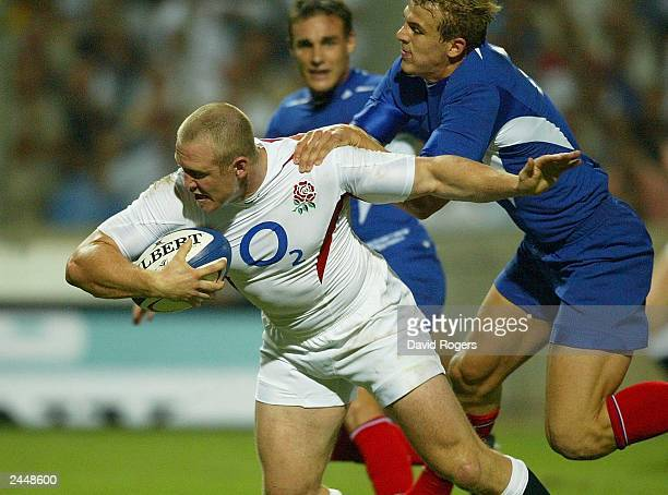 Mike Tindall of England breaks through the France defence to score a try during the Rugby Union International match on August 30 between France and...