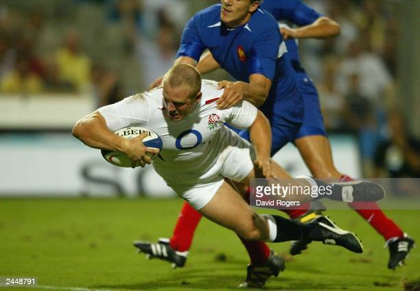 Mike Tindall of England goes over to score the first try of the match during the Rugby Union International match on August 30 between France and...