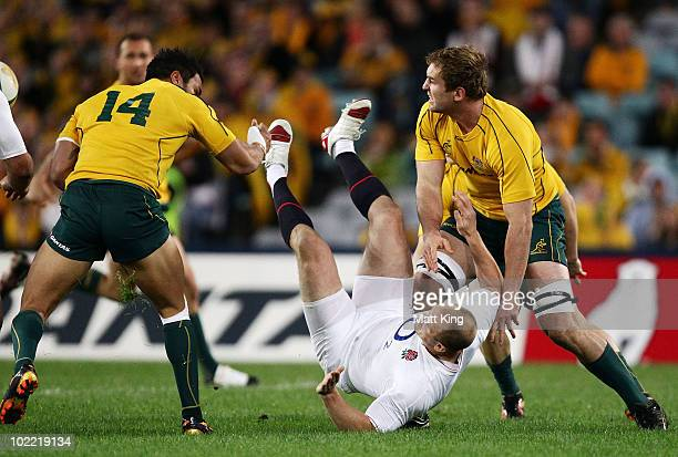 Mike Tindall of England is tackled during the Cook Cup Test Match between the Australian Wallabies and England at ANZ Stadium on June 19, 2010 in...
