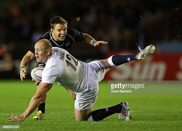 Mike Tindall of England slips over during the Rugby Aid 2015 celebrity rugby match between England and the Rest of the World at The Stoop on...