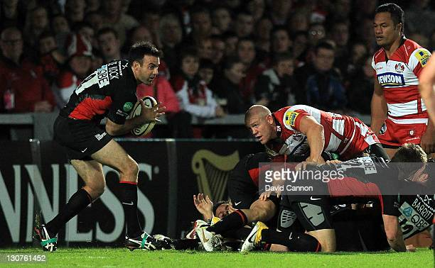 Mike Tindall of Gloucester caught on top of a ruck as Neil de Kock of Saracens clears the ball during the Aviva Premiership match between Gloucester...