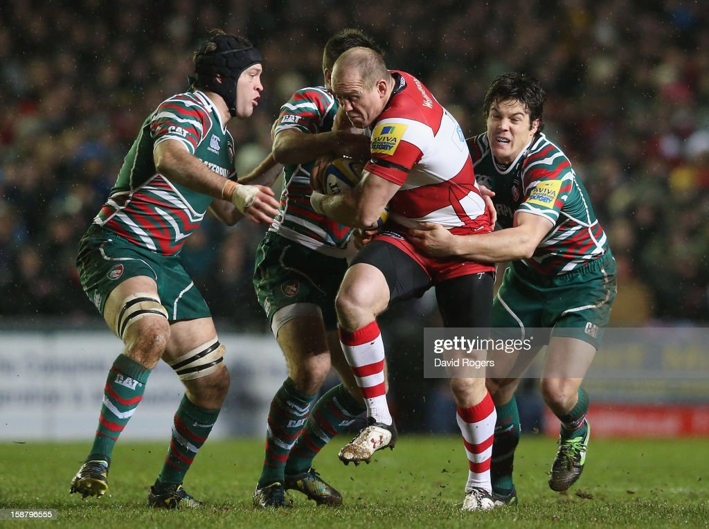 Mike Tindall of Gloucester is held by Anthony Allen (R) and Julian Salvi during the Aviva Premiership match between Leicester Tigers and Gloucester at Welford Road on December 29, 2012 in Leicester, England.