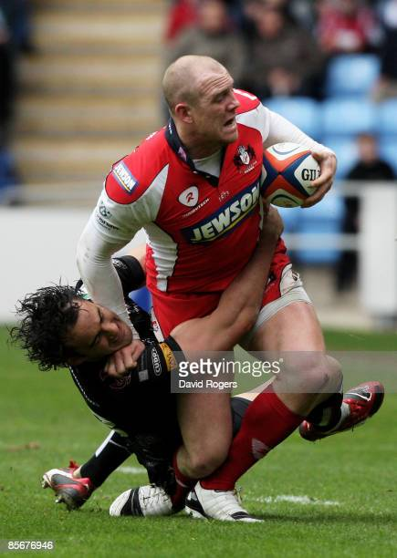Mike Tindall of Gloucester is injured as he is tackled by Sonny Parker of the Ospreys during the EDF Energy Cup Semi Final between Gloucester and...