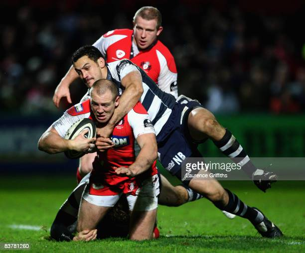 Mike Tindall of Gloucester is tackled by Neil Brew of Bristol to score a try during the Guinness Premiership Match between Gloucester Rugby and...