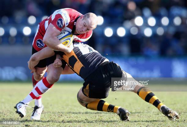 Mike Tindall of Gloucester is tackled by Sam Jones during the Aviva Premiership match between London Wasps and Gloucester at Adams Park on February...