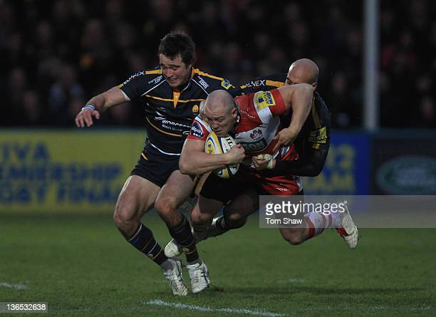 Mike Tindall of Gloucester is tackled during the Aviva Premiership match between Worcester and Gloucester at Sixways Stadium on January 7, 2012 in...