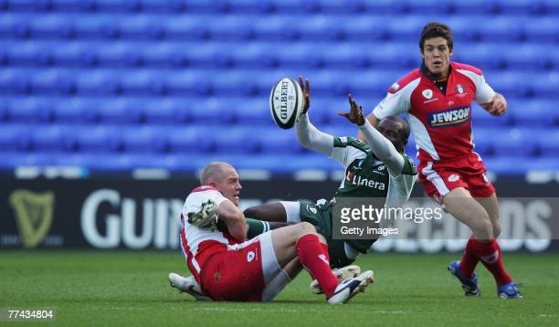 Mike Tindall of Gloucester tackles Topsy Ojo of London Irish during the Guinness Premiership match between London Irish and Gloucester at the...