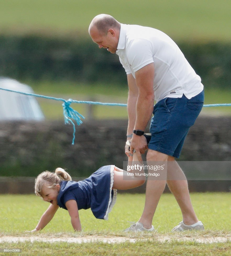 Mike Tindall plays wheelbarrows with daughter Mia Tindall as they attend the Maserati Royal Charity Polo Trophy Match during the Gloucestershire Festival of Polo at the Beaufort Polo Club on June 11, 2017 in Tetbury, England.