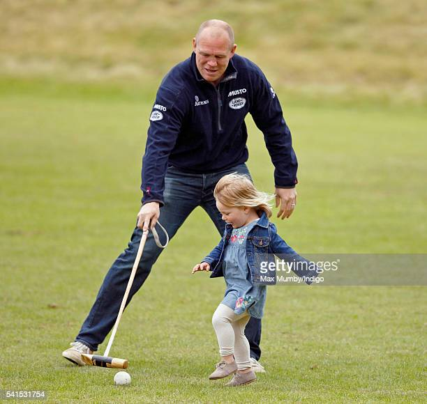 Mike Tindall plays with daughter Mia Tindall as they watch Zara Phillips play in a Jockeys vs Olympians charity polo match at the Beaufort Polo Club...