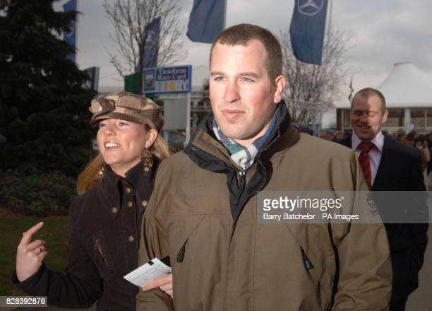 Mike Tindall shares a joke with Peter Phillips, son of the Princess Royal, and friend Autumn Kelly on their arrival at Cheltenham Races, Thursday...