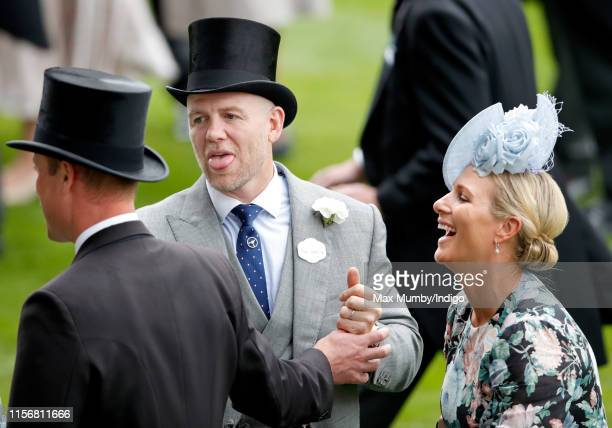 Mike Tindall sticks his tongue out at Prince William, Duke of Cambridge as they and Zara Tindall attend day one of Royal Ascot at Ascot Racecourse on...