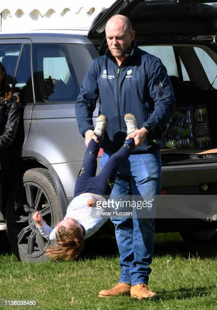 Mike Tindall swings daughter Mia Tindall during the Land Rover Novice & Intermediate Horse Trials at Gatcombe Park on March 24, 2019 in Stroud,...
