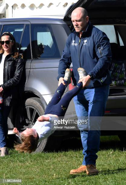 Mike Tindall swings daughter Mia Tindall during the Land Rover Novice Intermediate Horse Trials at Gatcombe Park on March 24 2019 in Stroud England