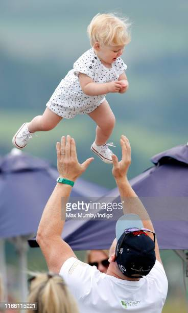 Mike Tindall throws daughter Lena Tindall into the air as they attend day 3 of the 2019 Festival of British Eventing at Gatcombe Park on August 4,...