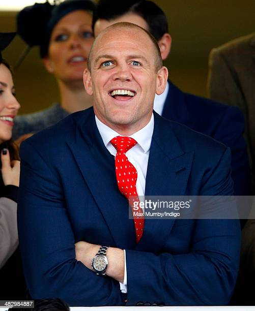 Mike Tindall watches his horse Monbeg Dude run in the Crabbie's Grand National horse race at Aintree Racecourse on April 5 2014 in Liverpool England