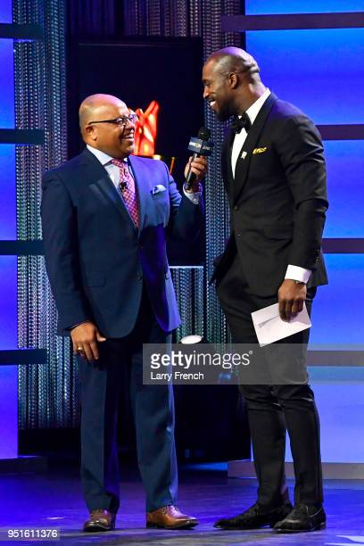 Mike Tirico and Vernon Davis speak onstage during the Team USA Awards at the Duke Ellington School of the Arts on April 26 2018 in Washington DC