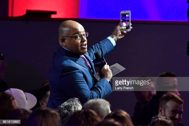 Mike Tirico takes a selfie with the audience during the Team USA Awards at the Duke Ellington School of the Arts on April 26, 2018 in Washington, DC.