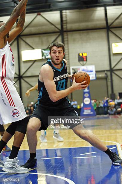 Mike Tobey of the Greensboro Swarm drives to the basket against the Grand Rapids Drive at The DeltaPlex Arena on December 30 2016 in Grand Rapids...