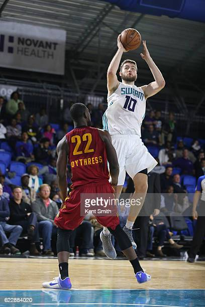 Mike Tobey of the Greensboro Swarm shoots against Alex Poythress of the Fort Wayne Mad Ants during the game at the The Field House at the Greensboro...