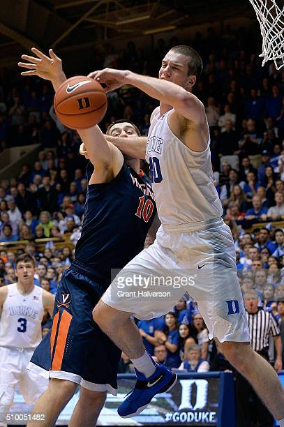 Mike Tobey of the Virginia Cavaliers battles Marshall Plumlee of the Duke Blue Devils for a rebound during their game at Cameron Indoor Stadium on...