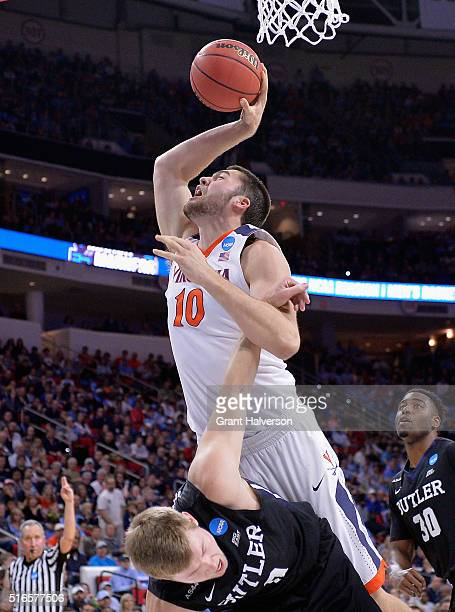 Mike Tobey of the Virginia Cavaliers loses control of the ball against Austin Etherington of the Butler Bulldogs in the second half during the second...
