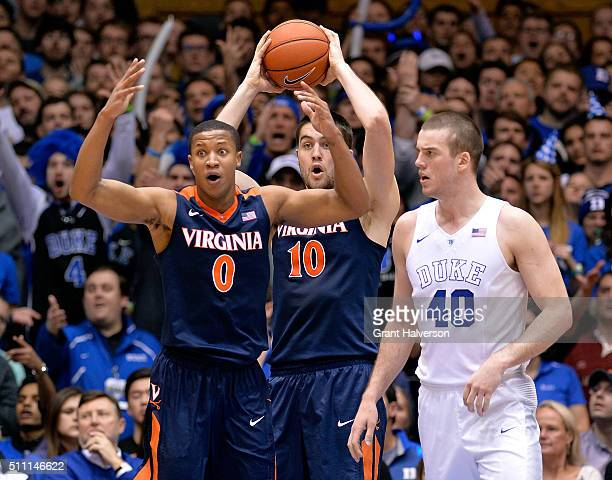 Mike Tobey of the Virginia Cavaliers reacts after being called for a foul against Marshall Plumlee of the Duke Blue Devils during their game at...