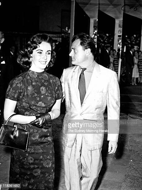 Mike Todd and Elizabeth Taylor arrive at Mark Foys Ballroom on 7 November 1957