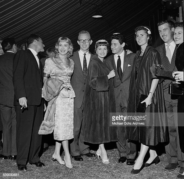 Mike Todd Lori Nelson Leon Tyler Actress Debbie Reynolds and Eddie Fisher pose during Mike Todd party in Los AngelesCA
