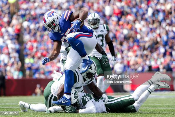 Mike Tolbert of the Buffalo Bills breaks a tackle during the first half against the New York Jets on September 10 2017 at New Era Field in Orchard...