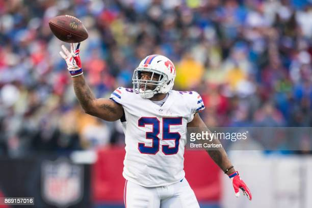 Mike Tolbert of the Buffalo Bills flicks the ball to officials after a carry during the game against the Oakland Raiders at New Era Field on October...