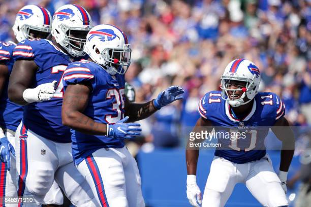 Mike Tolbert of the Buffalo Bills is greeted by teammates after scoring a touchdown during the second half against the New York Jets on September 10...
