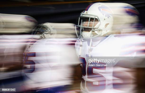 Mike Tolbert of the Buffalo Bills walks through the tunnel before a game against the New England Patriots at Gillette Stadium on December 24 2017 in...