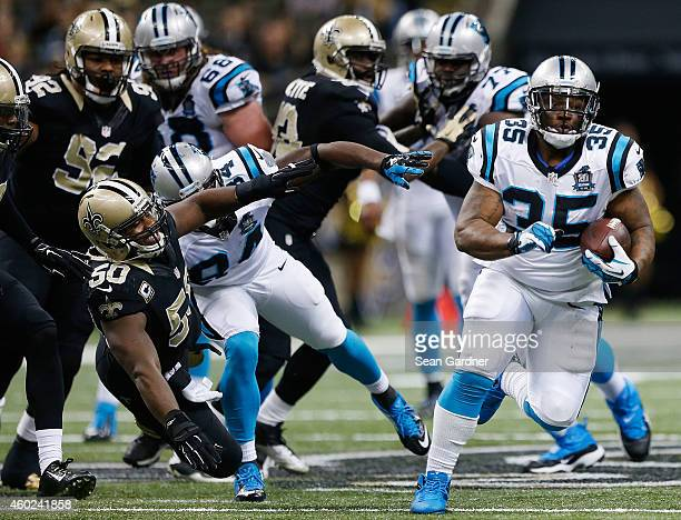 Mike Tolbert of the Carolina Panters rushes the ball against the New Orleans Saints during a game at MercedesBenz Superdome on December 7 2014 in New...