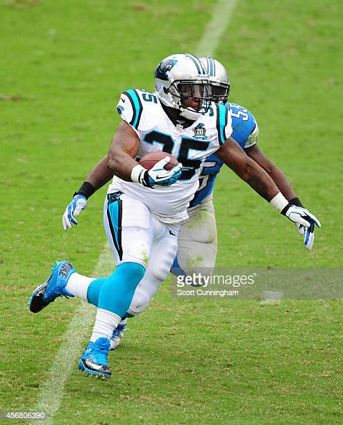 Mike Tolbert of the Carolina Panthers carries the ball against Stephen Tulloch of the Detroit Lions at Bank of America Stadium on September 14 2014...