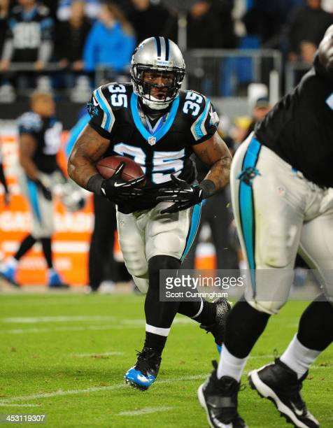 Mike Tolbert of the Carolina Panthers carries the ball against the New England Patriots at Bank of America Stadium on November 18 2013 in Charlotte...