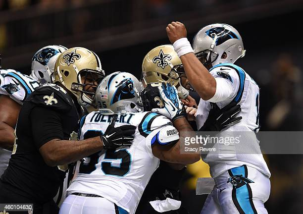 Mike Tolbert of the Carolina Panthers gets into a fight with New Orleans Saints player Cameron Jordan after a touchdown at MercedesBenz Superdome on...